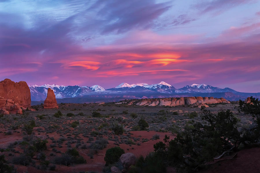Magnificent Sunset on the La Sal Mountains with Spiral Cloud Formations in Arches National Park by Ami Parikh