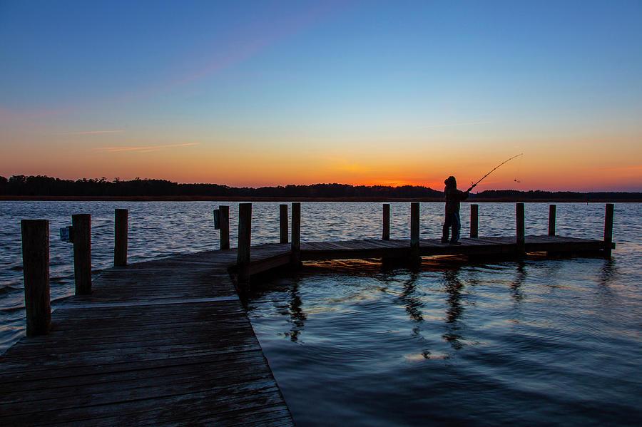 Man Fishing At Sunset Photograph