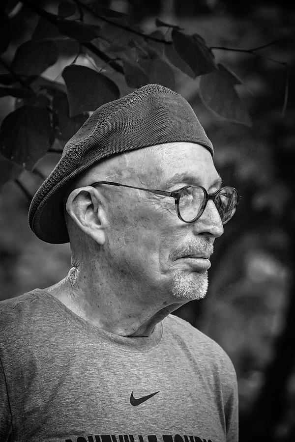 Man Photograph - Man In A Nike Shirt by John Haldane