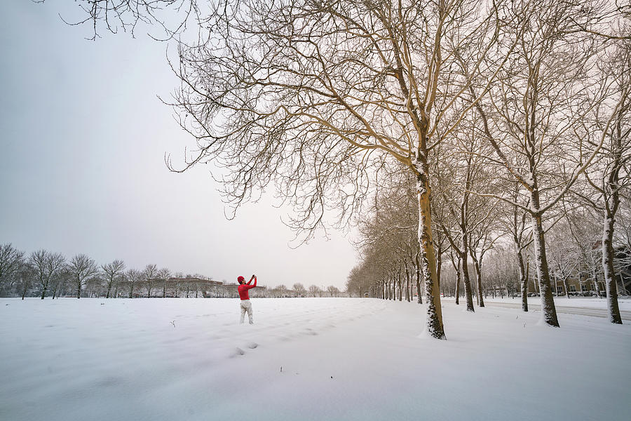 America Photograph - Man In Red Taking Picture Of Snowy Field And Trees by William Freebilly photography