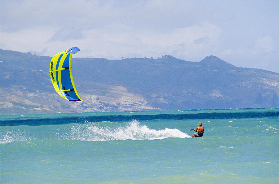 Pacific Islands Photograph - Man Kiteboarding In Turquoise Water by Mark Cosslett