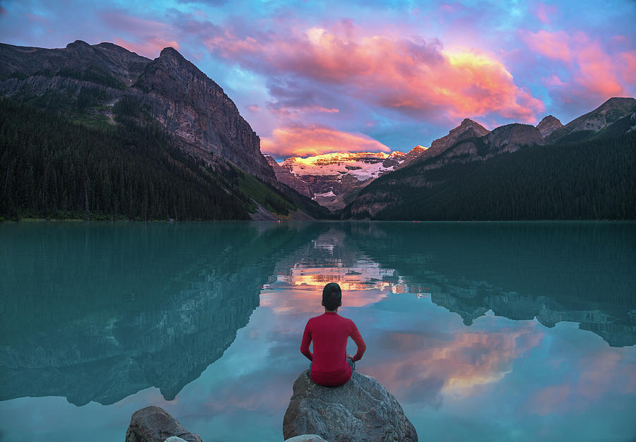 Man Sit On Rock Watching Lake Louise Morning Clouds With Reflect Photograph