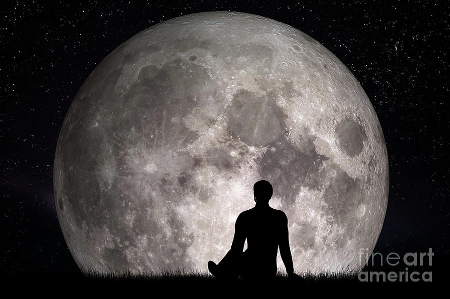 man sitting alone on grass and looking on moon imagine the future