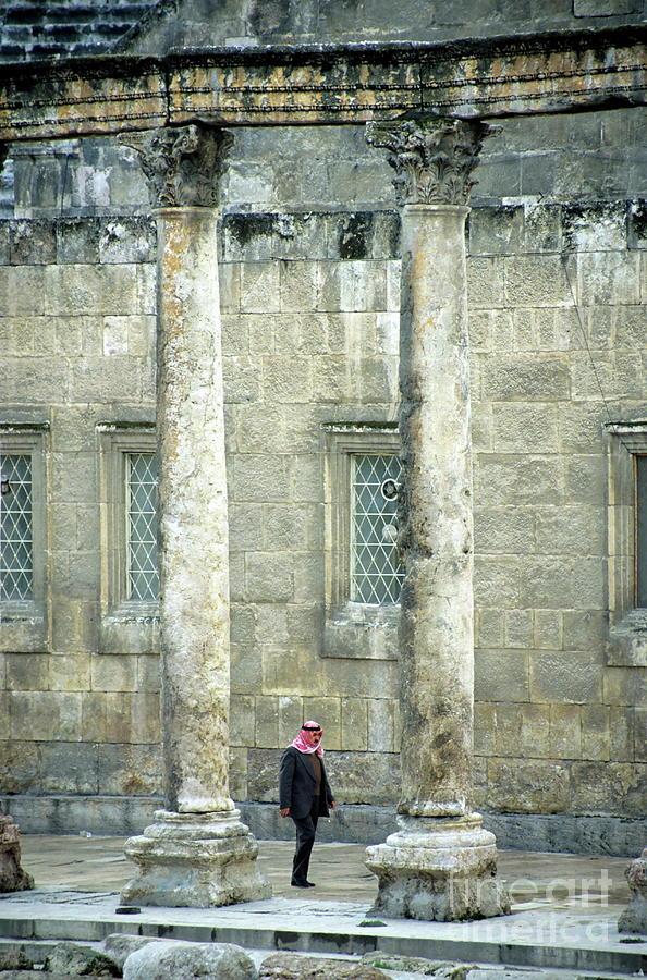Adult Photograph - Man Walking Between Columns At The Roman Theatre by Sami Sarkis