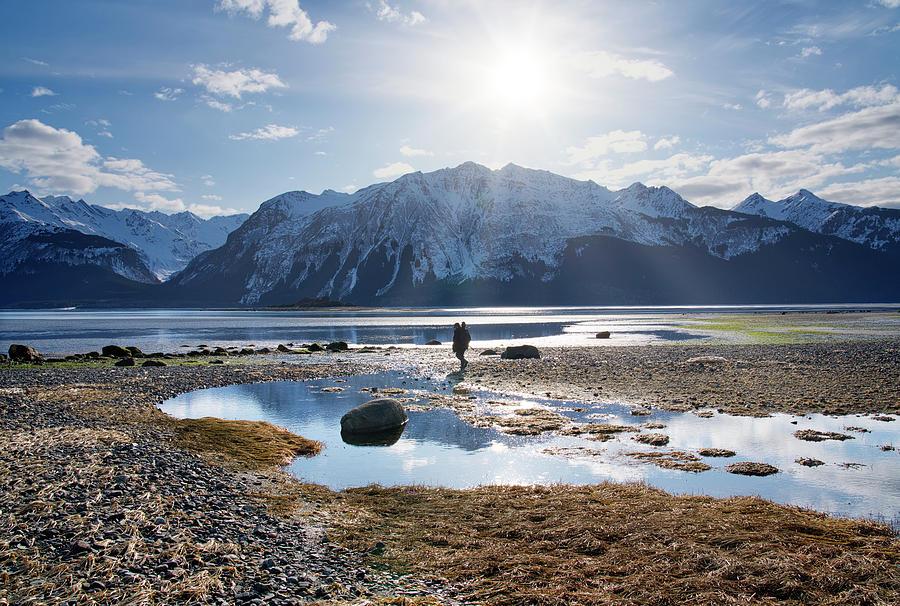 Man walking on Southeast Alaskan Beach by Michele Cornelius