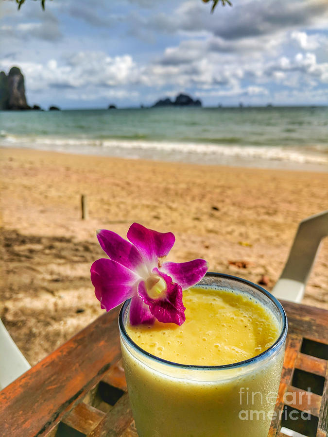 Thailand Photograph - Mango shake with flower by the sea in Thailand by Nicholas Braman
