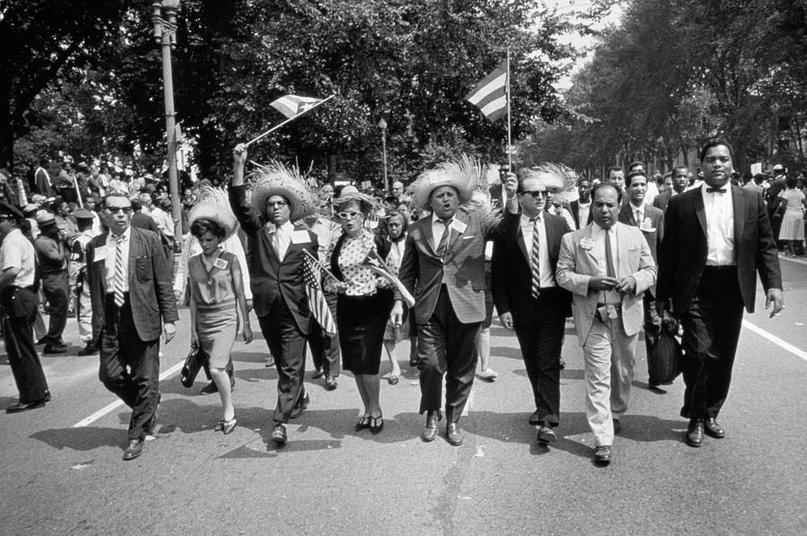 Photo Photograph - Marchers Wearing Hats Carry Puerto Rican Flags Down Constitution Avenue by Nat Herz