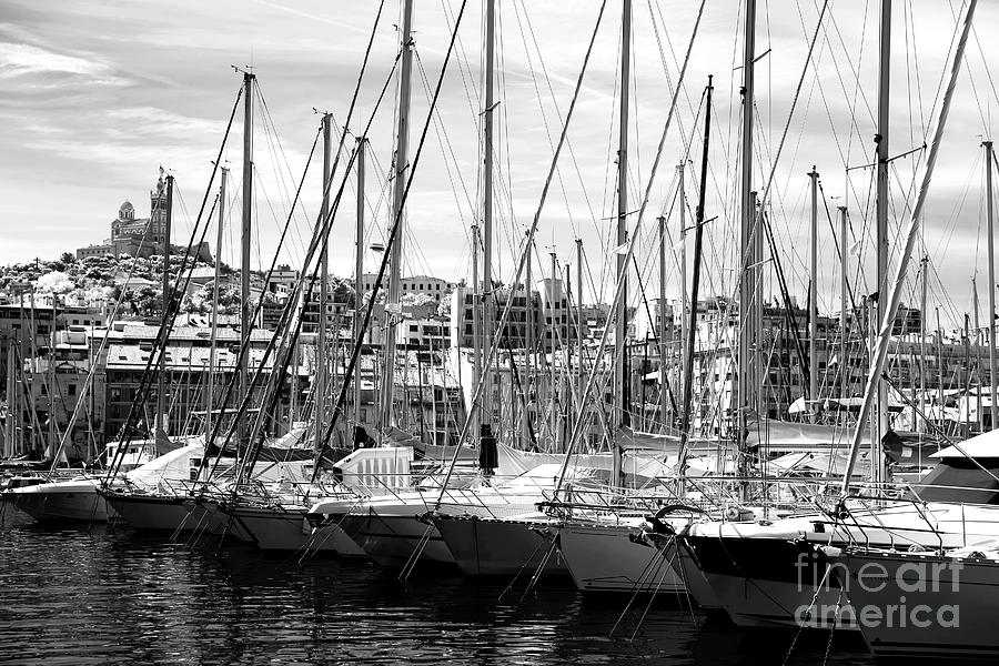 Masts Photograph - Masts In The Harbor by John Rizzuto