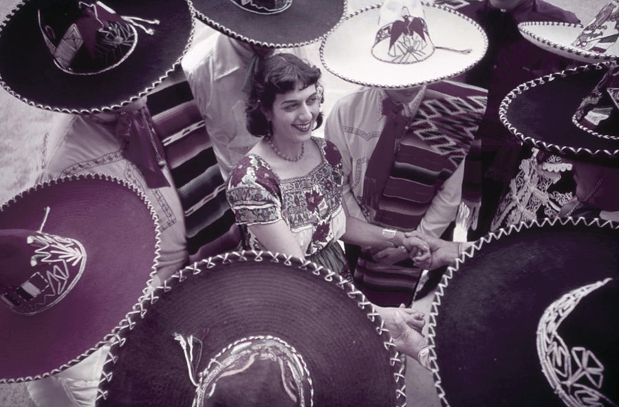 Outdoors Photograph - Men In Sombreros Surround A Woman by B. Anthony Stewart