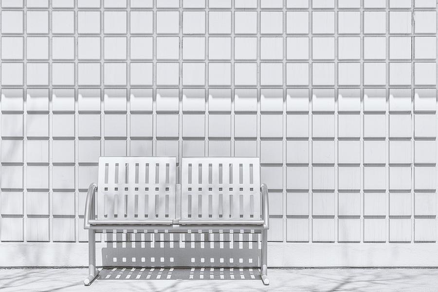 Metal Bench Against Concrete Squares Photograph