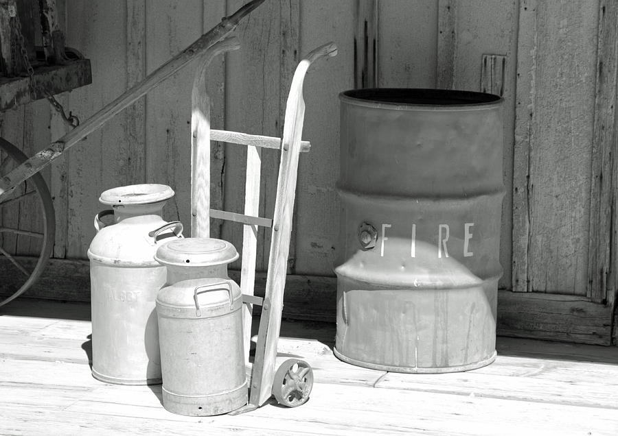 Black And White Photograph - Milk Cans And Fire Barrel by Troy Montemayor