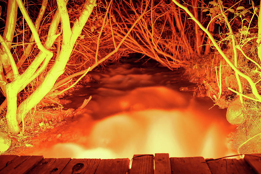 Mo Fiyah, Looking Up From A Small Bridge Over An Illuminated Creek During Summer In South Reno, Nv Photograph