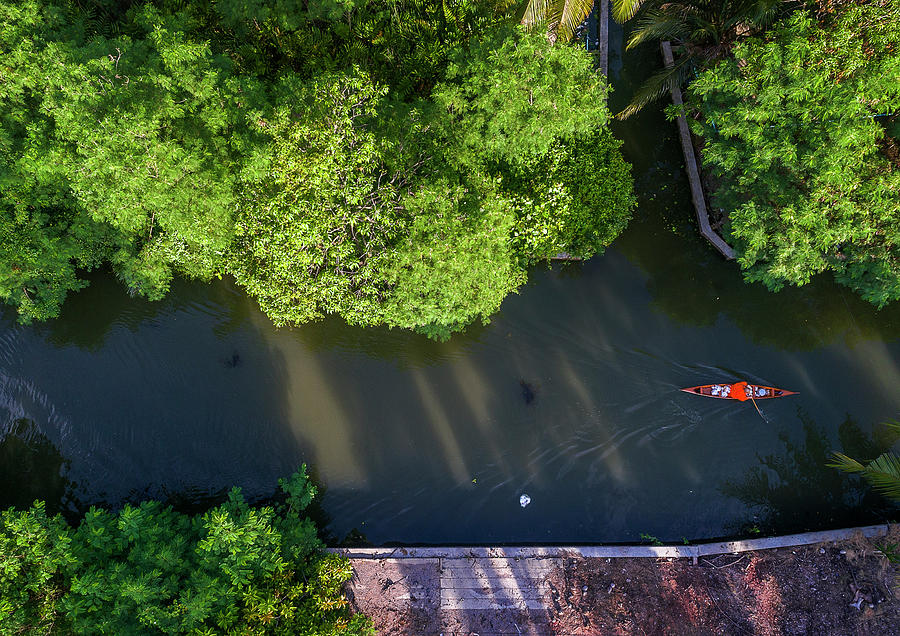 Monk rowing boat along floating market aerial view by Pradeep Raja PRINTS