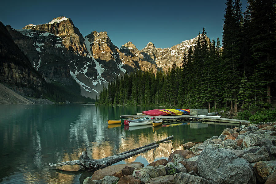 Moraine Lake Canoes by Ward Cameron