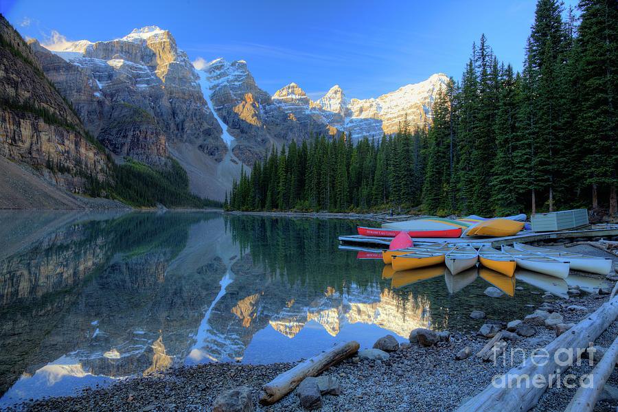 Autumn Photograph - Moraine Lake Sunrise Blue Skies Canoes by Wayne Moran