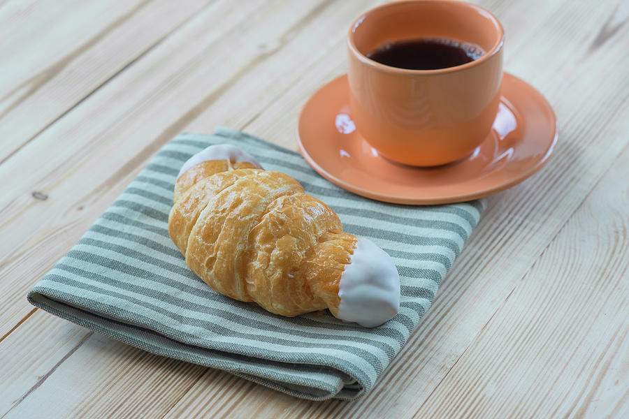 Coffee Photograph - Morning Coffee And Croissant On Wooden Table by Mariia Kalinichenko