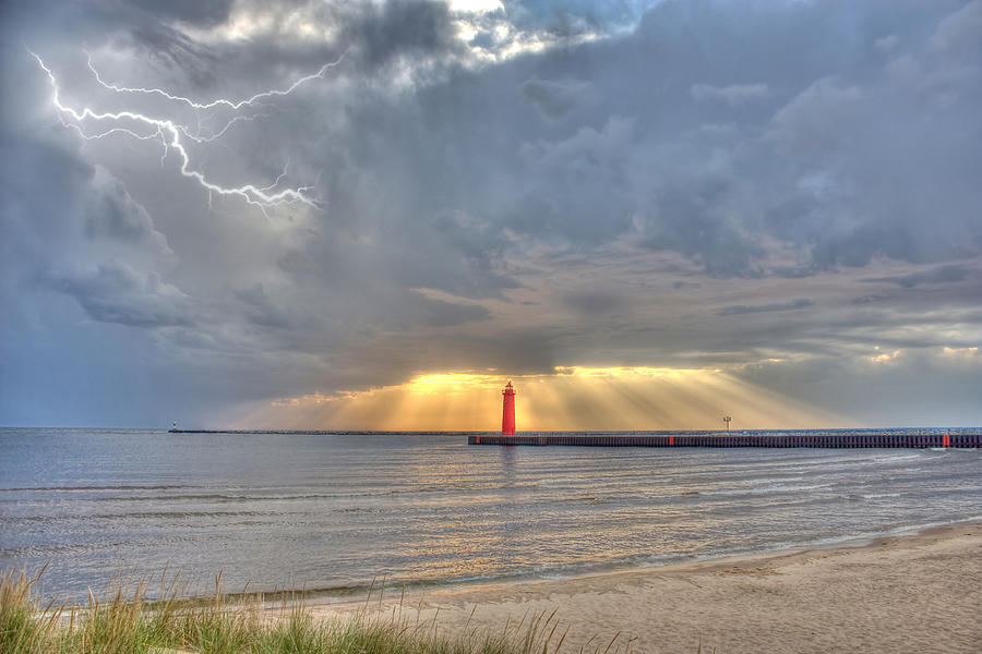 Lightning Photograph - Muskegon Lighthouse Lightning And Radiance Sunset by Jeramie Curtice