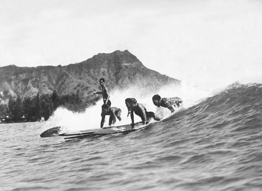 1920s Photograph - Native Hawaiians Surfing by Underwood Archives