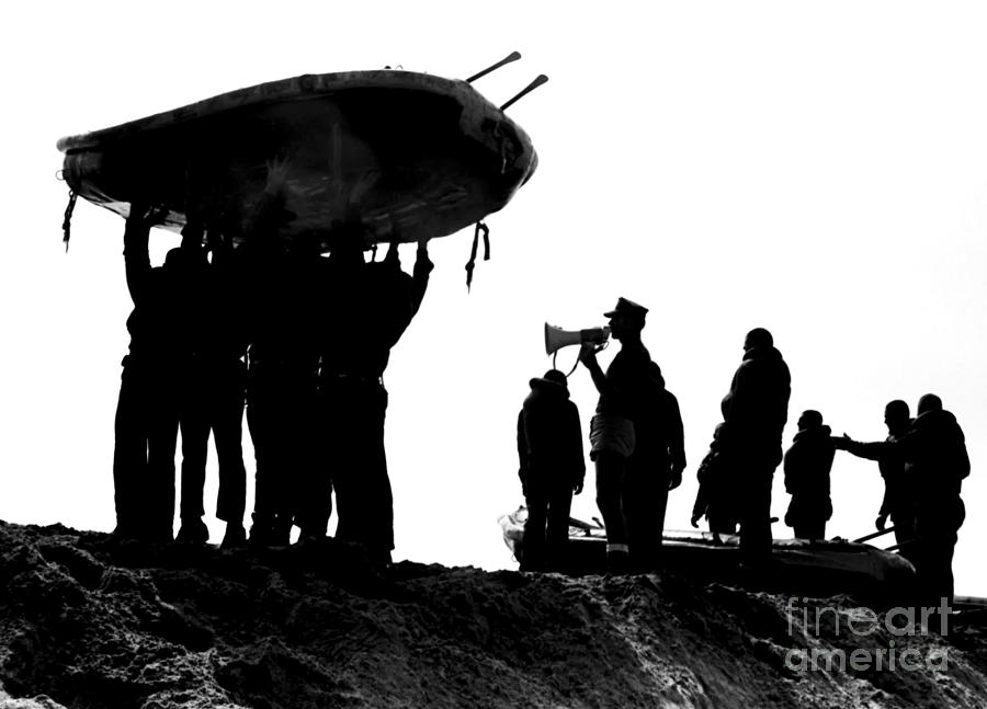 Military Photograph - Navy Seals Hold An Inflatable Boat by Michael Wood
