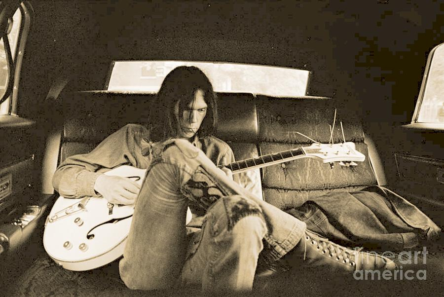 Neil Photograph - Neil Young in the Backseat by John Malone