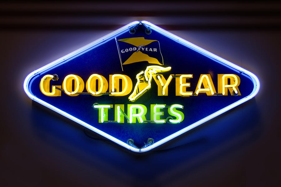 Transportation Photograph - Neon Goodyear Tires Sign by Mike McGlothlen