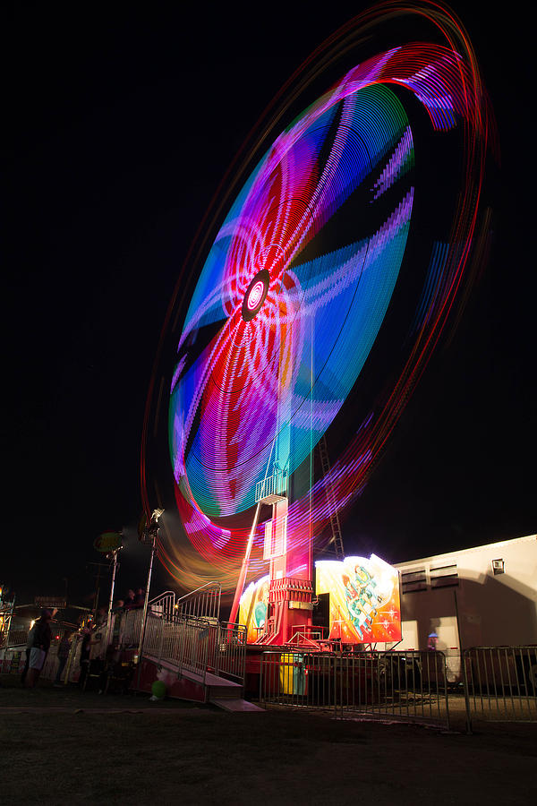 Fair Photograph - Neon Twirl by Bryan Moore