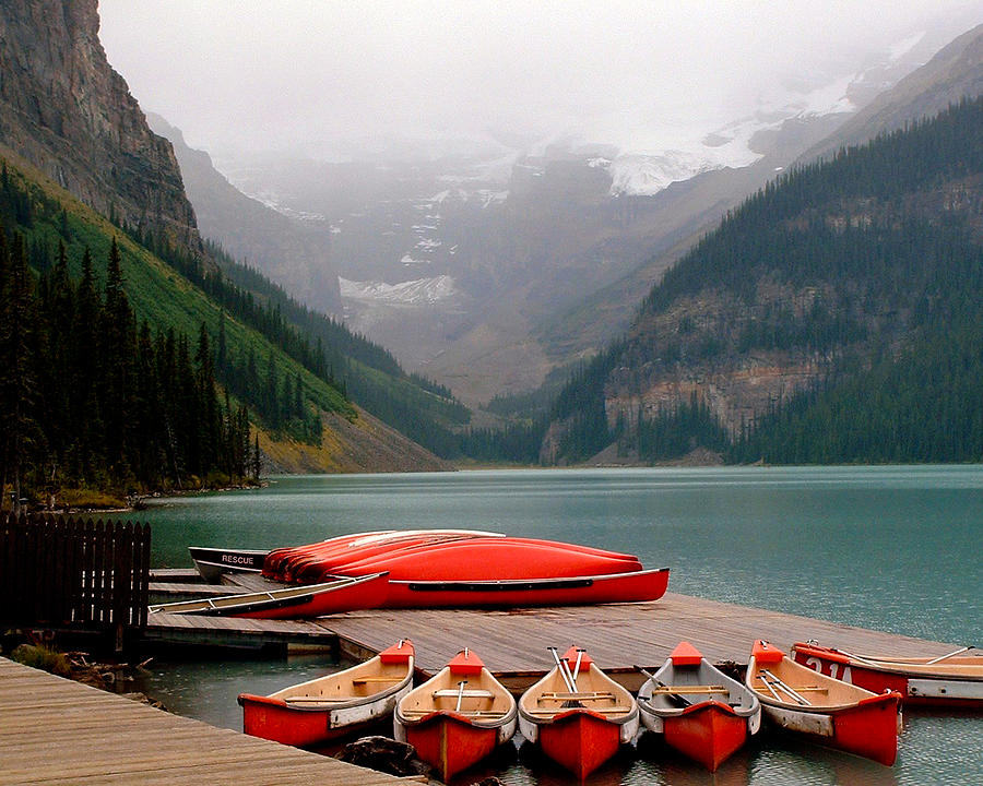 Lake Louise Photograph - Nestled Boat Launch by Diane Wallace