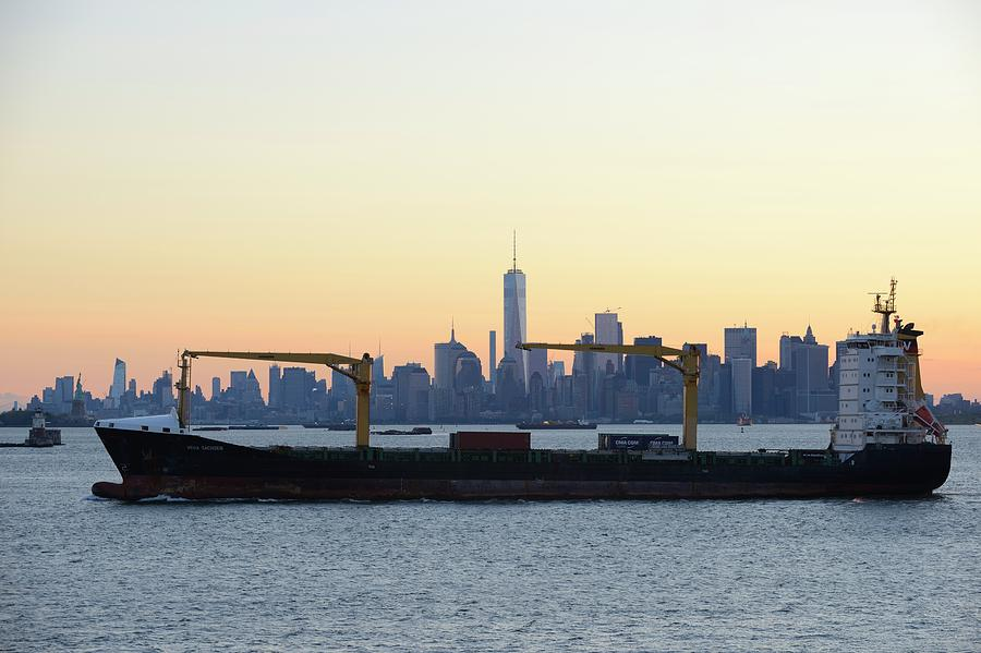 Skyline New York Photograph - New York City Skyline With Passing Container Ship by Merijn Van der Vliet