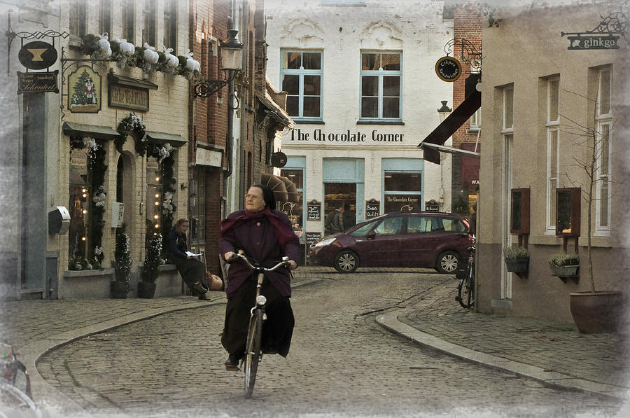 Architecture Photograph - Nun On A Bicycle In Bruges by Joan Carroll