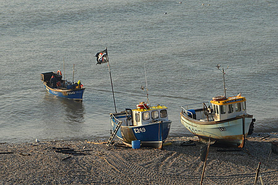 Fishermen Photograph - Off To Sea by Andy Thompson