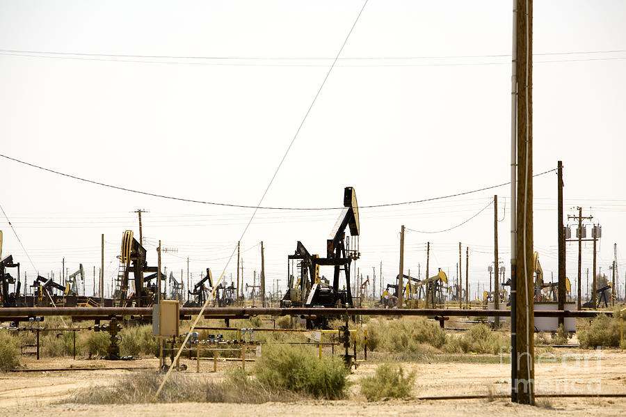 Arid Photograph - Oil Rigs, Lebec, Mojave Desert, California by Paul Edmondson