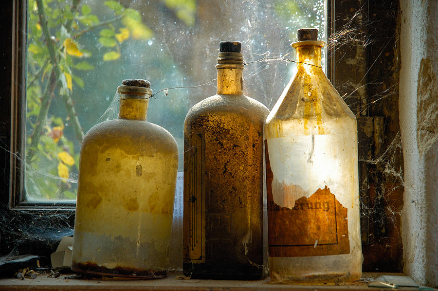 Bottles Photograph - Old And Dusty Glass Bottles by Matthias Hauser