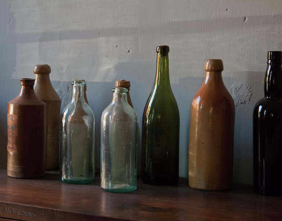 Old Photograph - Old Bottles In North Light by Michael Flood