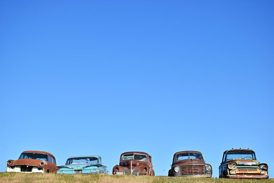 Cars Photograph - Old Cars In A Field by Steven Liveoak