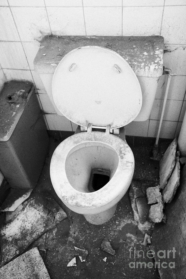 Old Photograph - Old Dirt Covered Toilet In An Old Factory Warehouse Unit Belfast Northern Ireland Uk by Joe Fox