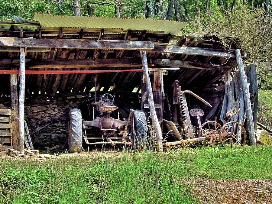 Old Farm Equipment In A Run Down Shed Photograph By John