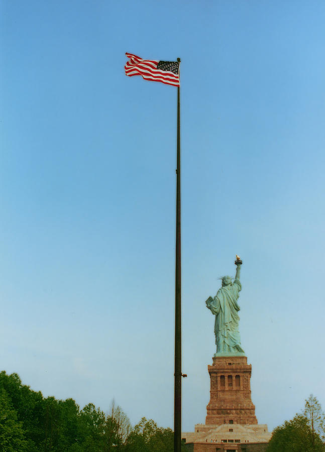 Statue Of Liberty Photograph - Old Glory And Lady Liberty by Mark Fuller