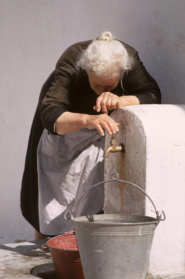 Old Photograph - Old Lady With Water Pail by Carl Purcell