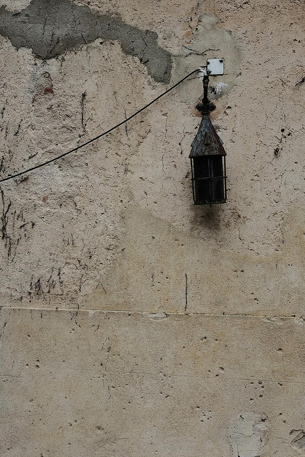 Old Lantern On A Weathered Wall Photograph