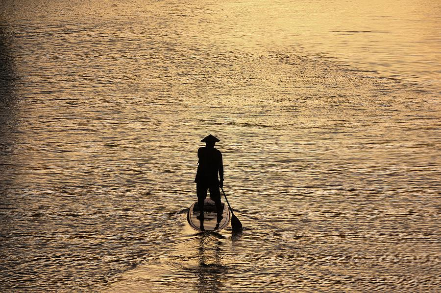 Landscape Photograph - Old man paddling into the sunset by M C Hood