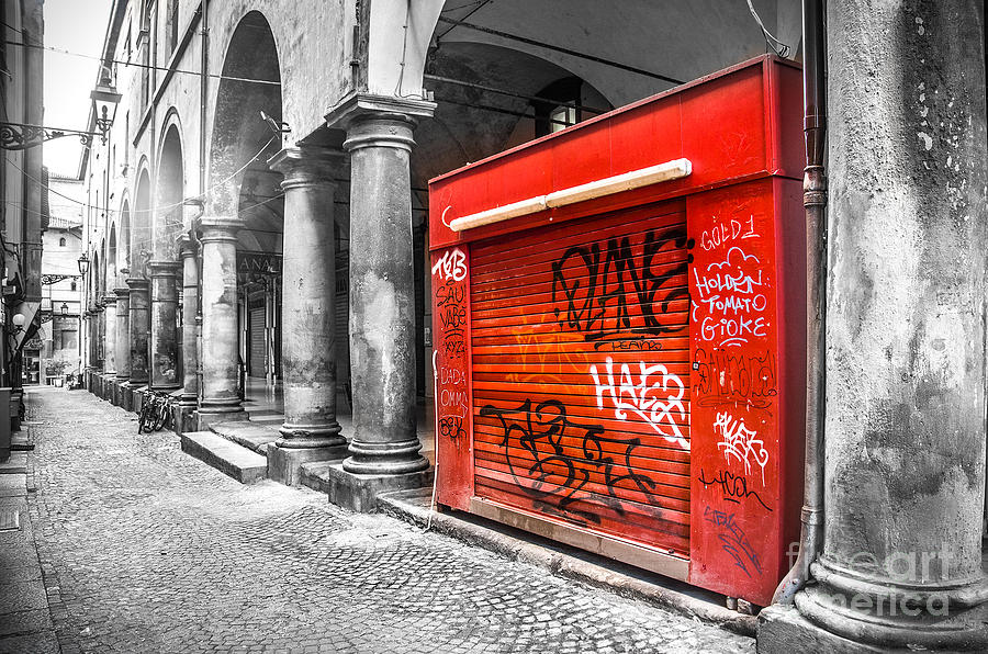 Black And White Photograph - Old Newsstand Closed In Bologna Canvas - Technique Of Selective Color -  Black And White Only Red by Luca Lorenzelli