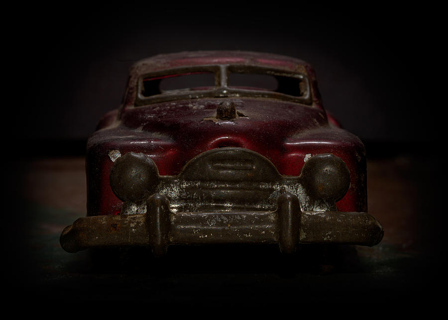 Old Toys Photograph - Old Red Toy Car Front by Art Whitton