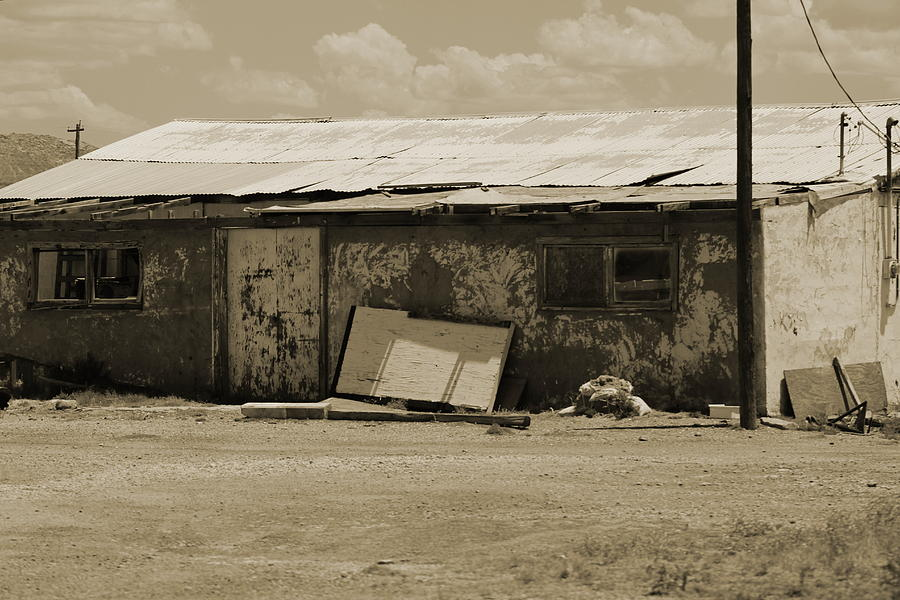 Sepia Photograph - Old Rundown Building In Sepia Tones by Colleen Cornelius