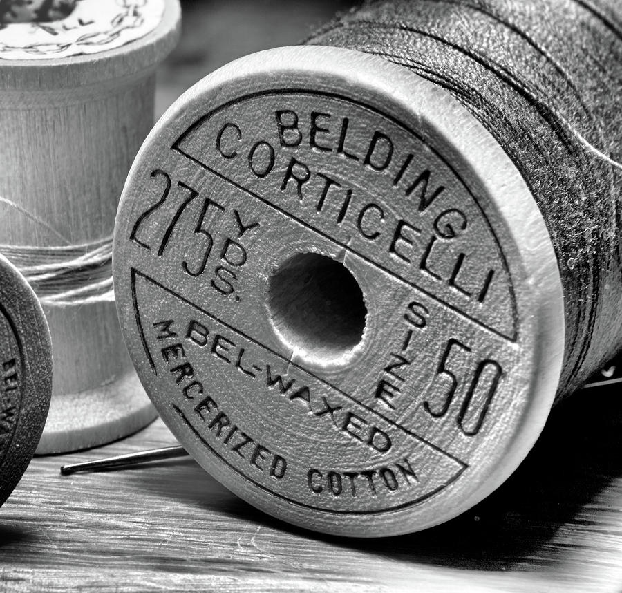 Old Spool Of Thread In Black In White Photograph