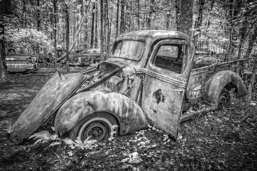 1930s photograph old truck in the woods in black and white by debra and dave