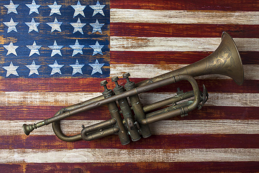 Brass Photograph - Old Trumpet On American Flag by Garry Gay