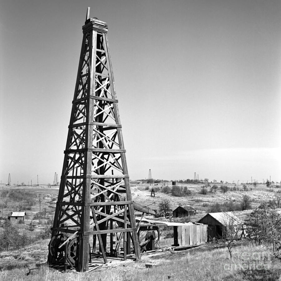 Oilfield Photograph - Old Wooden Derrick by Larry Keahey