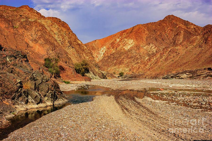 Arabia Photograph - Oman - Wadi or dry riverbed in Arabian desert. by Mano Chandra Dhas