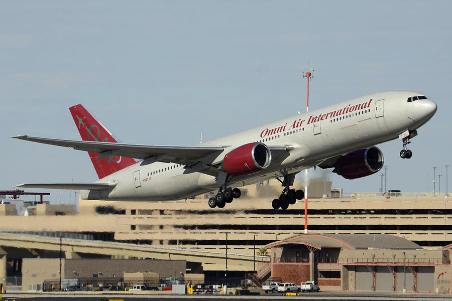 Airplane Photograph - Omni Air International Boeing 777-222 N927ax Phoenix Sky Harbor January 3 2015 by Brian Lockett