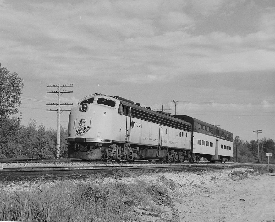 Diesel Engines Photograph - Passenger Train Cuts Through Countryside by Chicago and North Western Historical Society